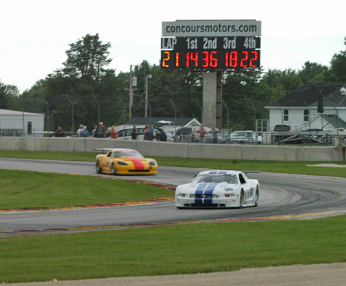 Cliff Ebben passes Tony Ave for the lead (photo credit: Mike Callahan)