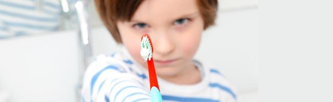 How do I get my preschooler to let me brush her teeth?